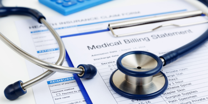 Medical bills and stethoscope